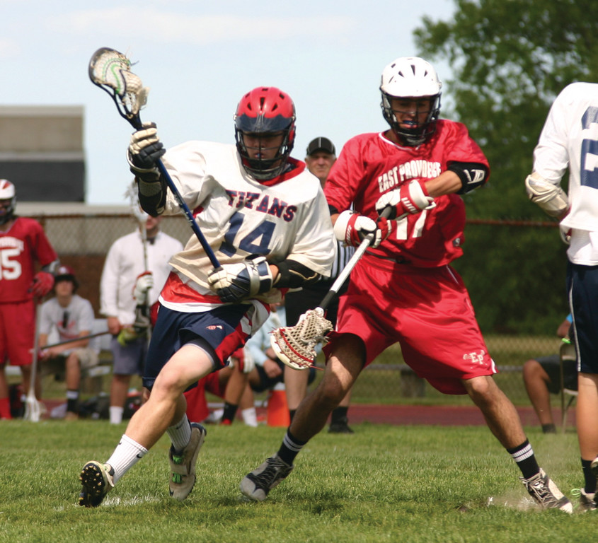 CUTTING IN: Toll Gate�s Jesse Butler gets around a defender in Friday�s game against East Providence.