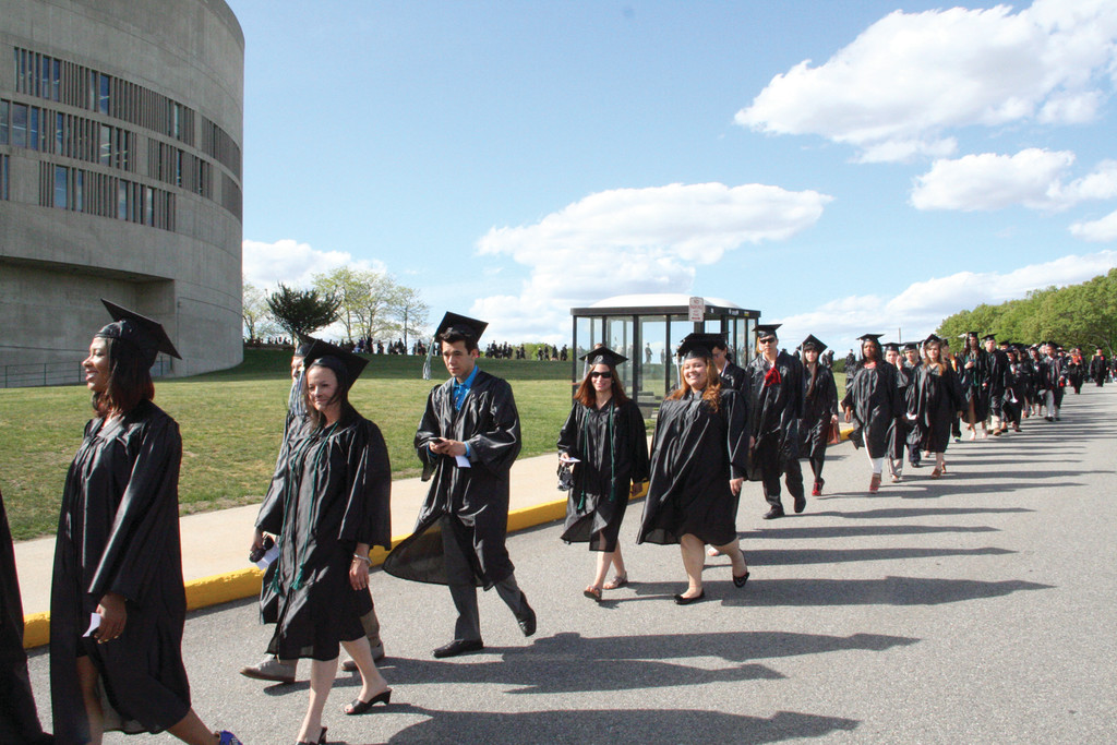 PROCESSION: The CCRI Class of 2013 extends from the college superstructure to the Cullen Field House at the start of commencement ceremonies Friday afternoon.