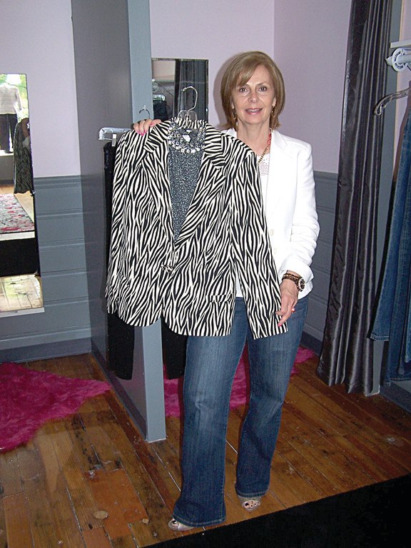ONE OF HER FAVORITES: Karen Calabro holds up one of her favorite pieces that have come in recently.