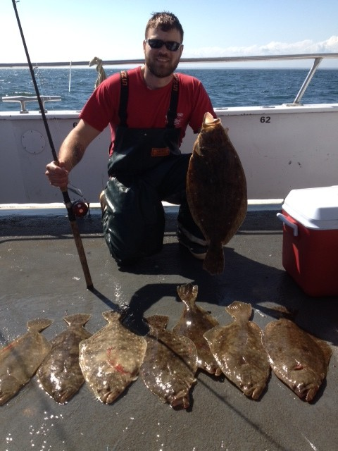 Fluke fishing is good: Cote Laflamme of Smithfield with some of the fluke (summer flounder) he and a friend caught while fishing aboard a Frances Fleet party boat. Cote caught eight keepers and then later in week landed an eight pound fluke of the center wall of the Harbor of Refuge, Narragansett.
