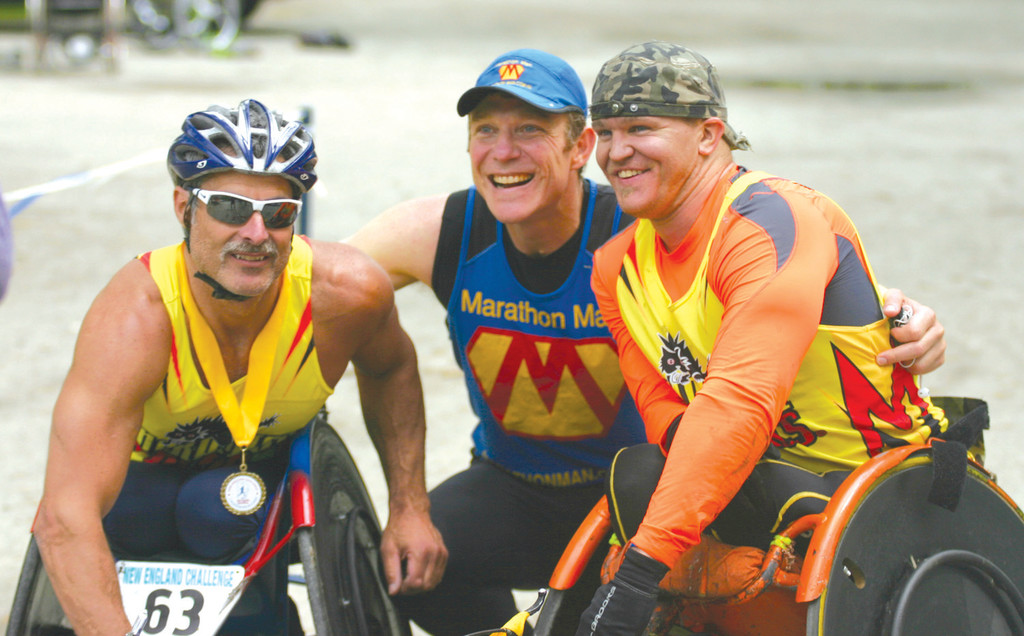 ON COURSE: Trent Morrow of Sydney, Australia, poses for photos with Grant Berthiaume and Aaron Roux of Tucson, Ariz., on Wednesday during a New England Challenge marathon in City Park. Morrow is attempting a world record for marathons in a year and raising money for cancer research, while Berthiaume and Roux are doing 50 marathons for charity
