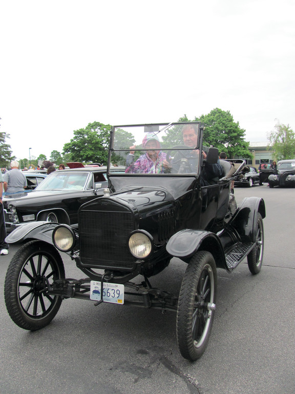FAST FROM THE PAST: Paul Crowell and his wife Kathy of Warwick are the proud owners of this 1923 Model-T Ford that drew rave reviews during Sunday's fourth annual Bishop Hendricken High school Car Show.