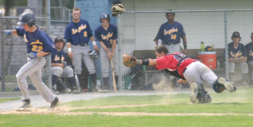 SPRAWLING: Toll Gate catcher Benn Mann, right, dives to tag Barrington's Brett Fay during Tuesday's game. Fay was out on the play.