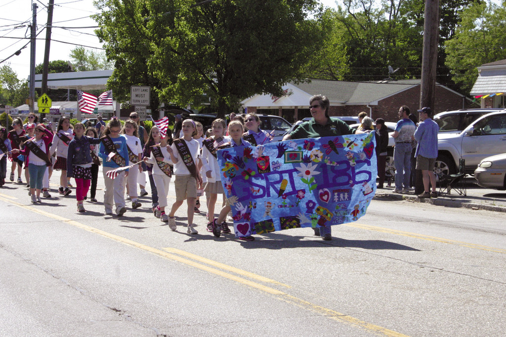 GIRL POWER: Girl Scouts Daisy Troop 186 show off their colorful banner.