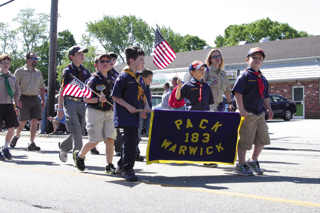 LEADING THE PACK: Cub Scouts Pack 183 march proudly during Monday's festivities.