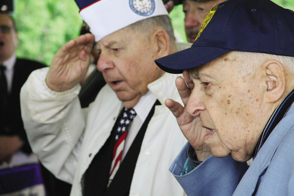 SALUTE: Melvin Kahn and Leon Resnick, both World War II veterans, pay tribute at Sunday's Memorial Wall of Honor ceremony at Lincoln Park Cemetery.