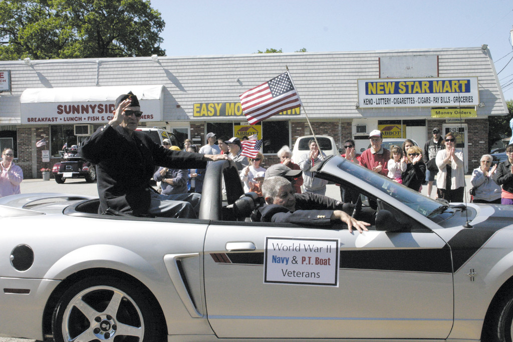 HONORING VETERANS: Veterans Ray Forcier (sitting in the backseat) and William Byrnes took part in this year's parade and were mentioned during the speaking program for their contributions to veteran's affair since World War II.