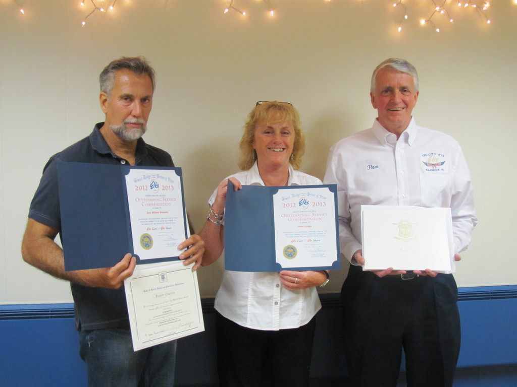 "AT AWARDS NIGHT: Mark Eaton (left), his wife Lori Eaton and Peter Dodge were among 15 people who received ""Outstanding Elks"" awards during Tri-City Lodge No. 14's annual awards night last Wednesday evening at the non-profit organization's headquarters on West Shore Road in Warwick."