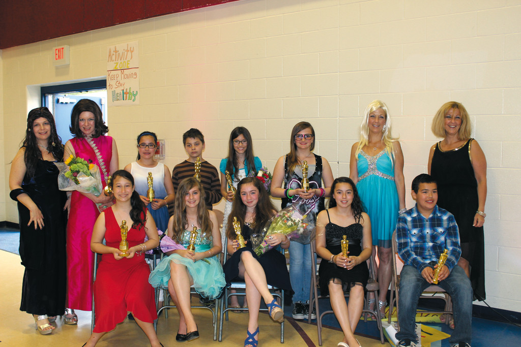 TOP WINNERS: Front row, from left, are Andrea DiMauro, Daphne Eckert, Brianna Devine, Anastasia Varela and Aaron Fox. Back row, from left, are: librarian Suzanne Skiffington, theater teacher Amy Budd, Chelsea Vieira, Zachary Bowen, Emily Hogan, Kyalee Corcoran and sixth grade teachers Mary Chisholm and Meg Shideler.