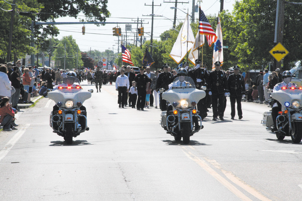 A MEMORABLE CELEBRATION: The Annual Memorial Day Parade kicked-off at about 9 a.m. on Memorial Day with a quartet of police officers leading the way.