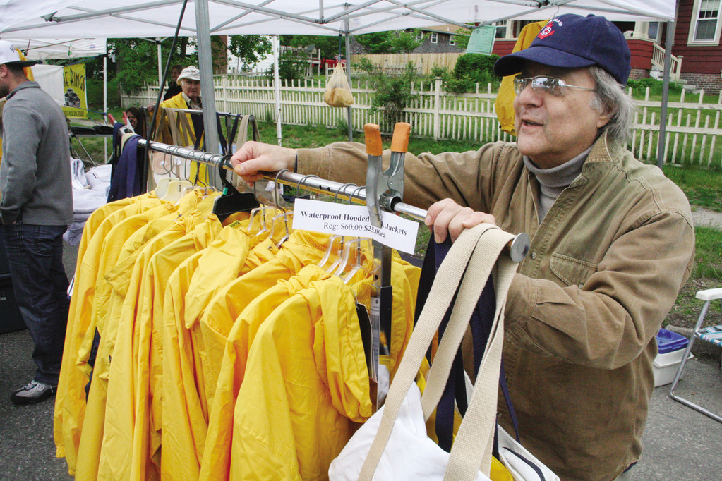 Nylon waterproof jackets were among the items Bob Sebastianelli of Cranston offered for sale from his booth at the Gaspee Days Arts and Crafts Festival which started off with a wet startbut came to a close yesterday with a beautiful day.