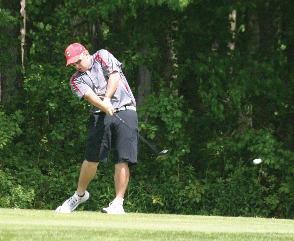 BIG HITTER: Cranston West's Steven Letterle hits his drive during the first round of the 2013 state tournament. Letterle shot 78 that day, en route to a tie for ninth-place finish overall.
