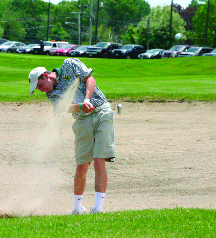 ON THE BEACH: Hendricken's Brandon Macedo hits the ball out of a sand trap on the first hole at Cranston Country Club during Tuesday's round at the state tournament