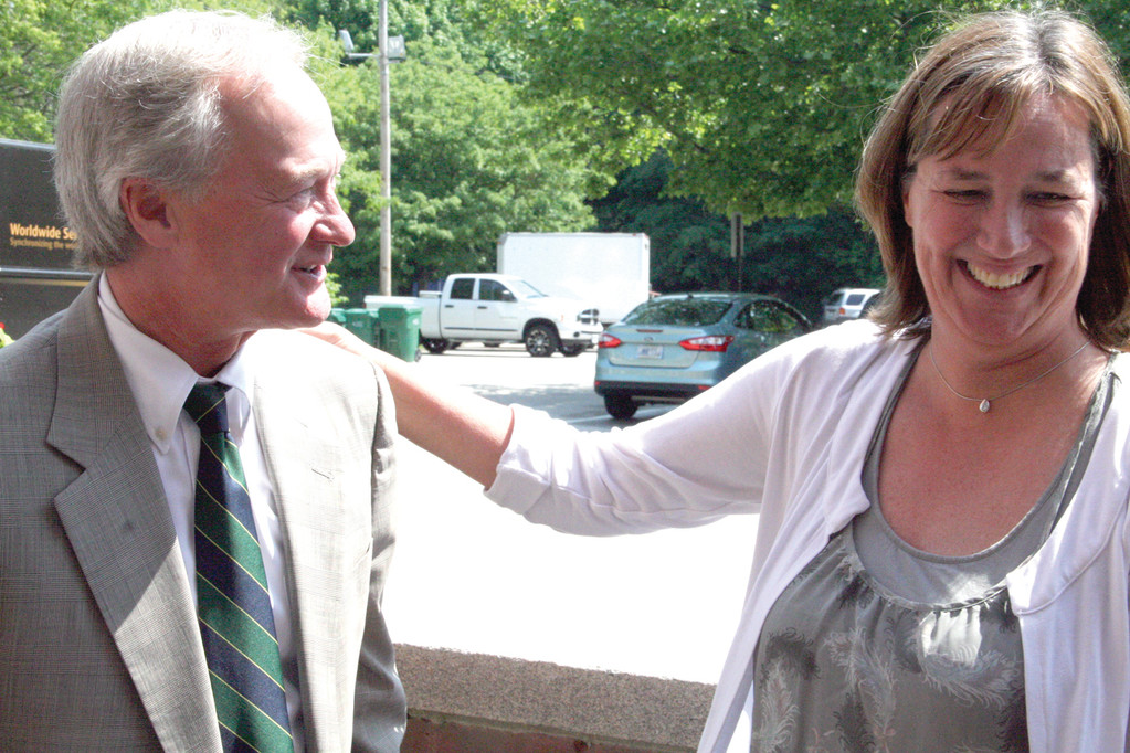HE'S BACK: City Clerk Marie Ahlert greets Gov. Chafee Thursday as he arrived at City Hall to 