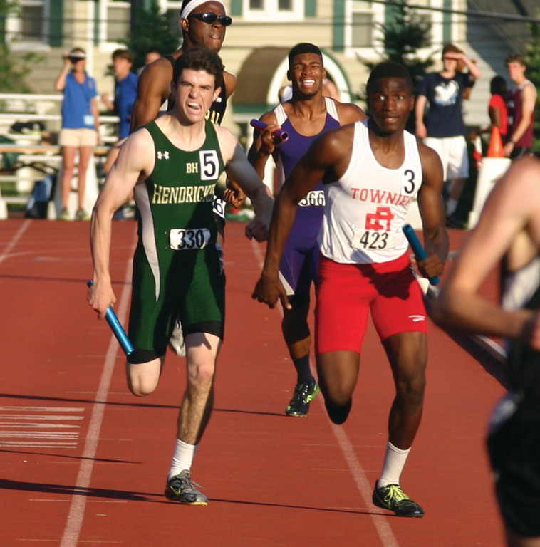 NECK AND NECK: Hendricken�s Cameron Ricci and East Providence�s Joshua Rambert sprint to the finish in the 4x400 relay, which decided the title in favor of EP.