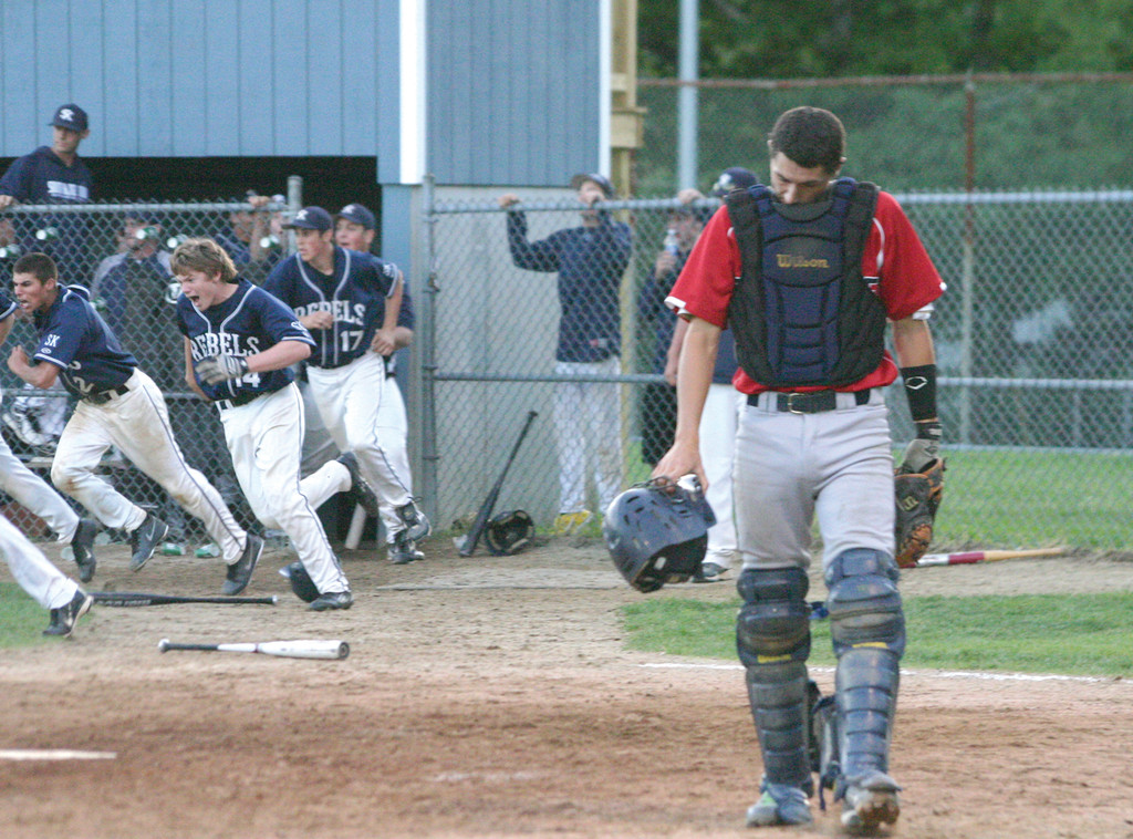 TOUGH ENDING: Toll Gate�s Ben Mann leaves the field as South Kingstown celebrates its walk-off victory over the Titans in Tuesday�s playoff game. The loss ended Toll Gate�s season.