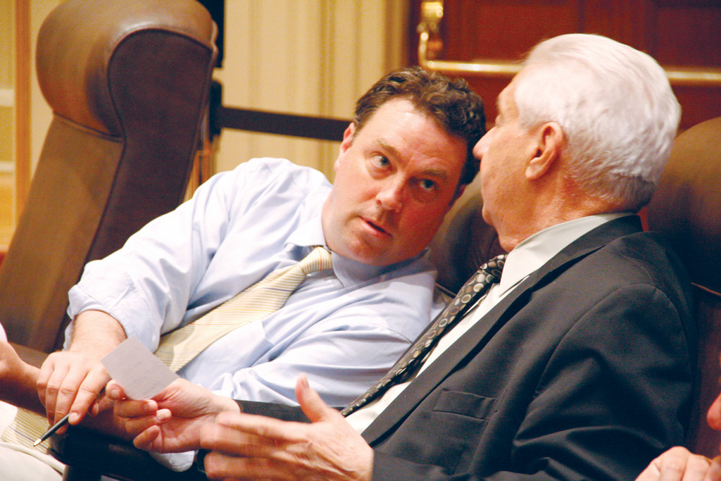 BUDGET TALK: Councilmen Charles Donovan Jr. and Joseph Gallucci confer during Monday�s budget hearing.