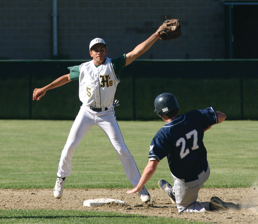 STRETCH: Hendricken's Lou Umberto leaps for the throw as Moses Brown's Elijah Brown steals second on Tuesday.