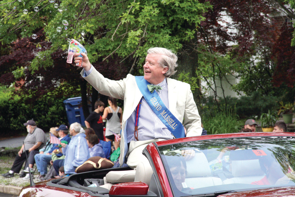 Blowing Bubbles: The Gaspee Parade Grand Marshal Bob Burke fires off bubbles.