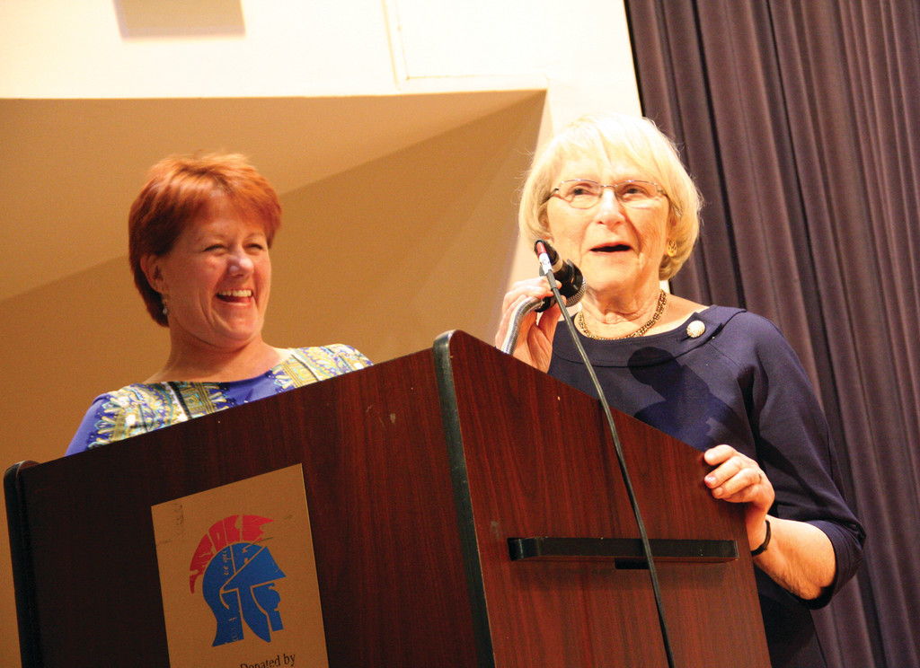 REMEMBERING BOB: Bethany Furtado, who served as master of ceremonies at the dedication of the Robert J. Shapiro Educational Complex, shares a laugh with Audrey Shapiro, widow of the late superintendent in ceremonies Friday night.