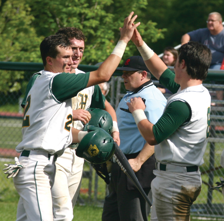 HIGH FIVES: Ed Markowski and John Toppa celebrate after another run in Hendricken's 15-2 victory over Moses Brown on Saturday.