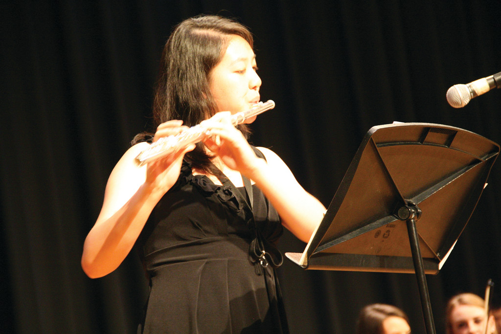 Playing a flute solo piece is Nina Yu. The musical program, directed by George Landrie, included classical, jazz and contemporary selections.
