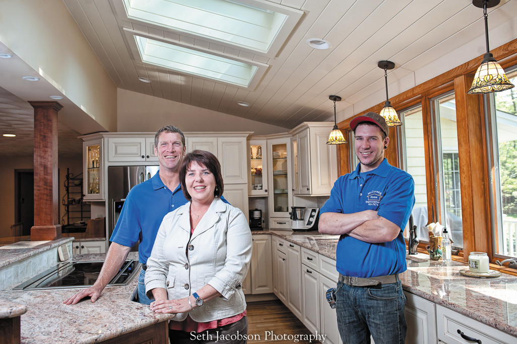 Owners Chris and Kristen McCormick and son Garrett showcase a newly completed kitchen remodel in Cumberland.