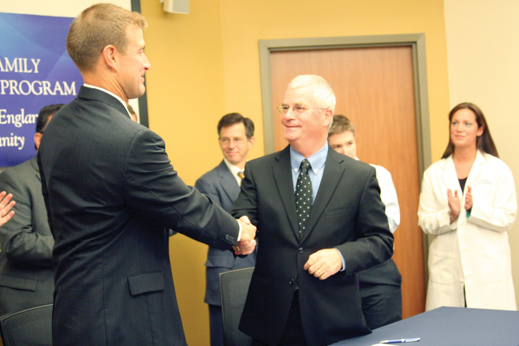 IT'S OFFICIAL: Chuck Jones and Dennis Keefe shake hands after signing an agreement between Kent Hospital and Thundermist.