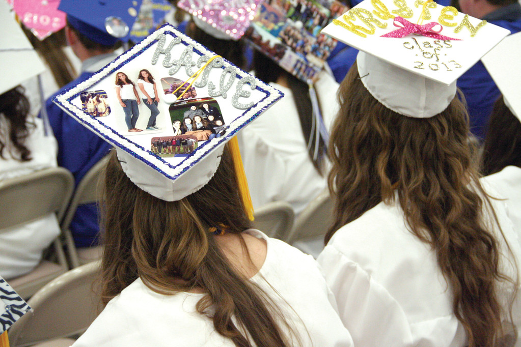 CREATIVE CAP, ARTISTIC FUTURE?: Vets students show off their creativity by decorating their graduation caps.