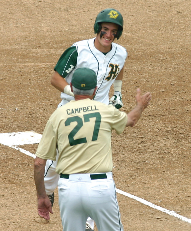 REASON TO SMILE: Ed Markowski gives assistant coach Bill Campbell a high-five on his way around third base after Markowski's solo home run on Sunday.