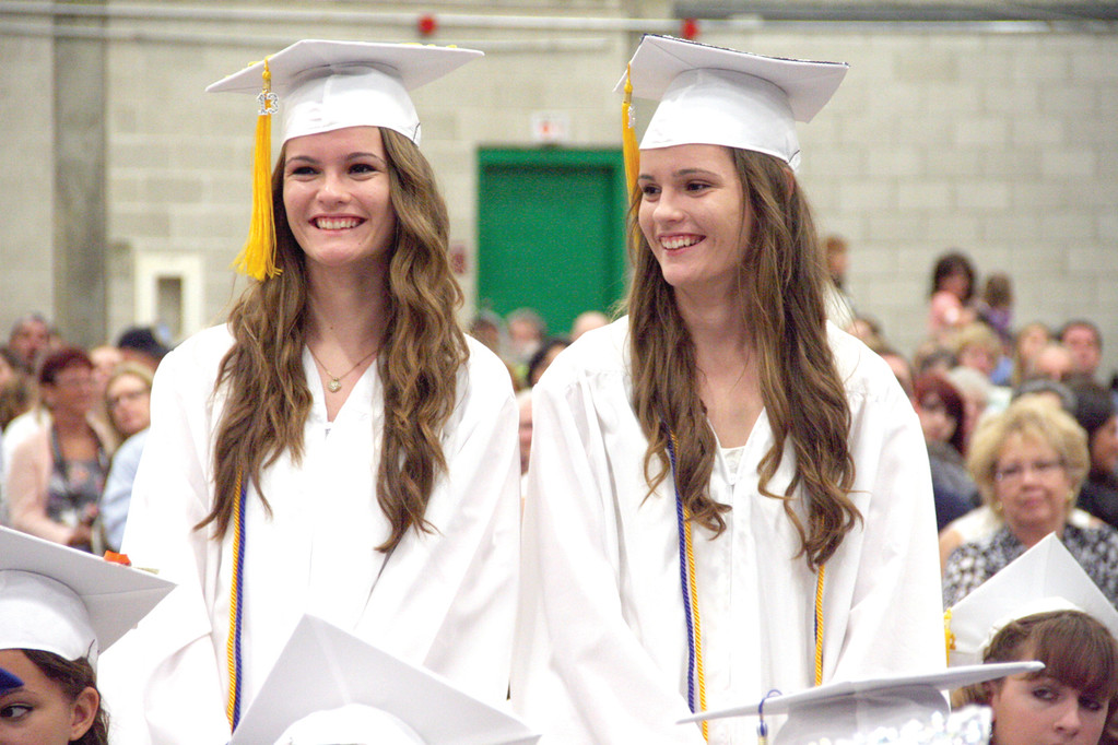 TWIN GRADUATES: Kristen and Katie Gregory stand to accept the Tim Packhem Scholarship.