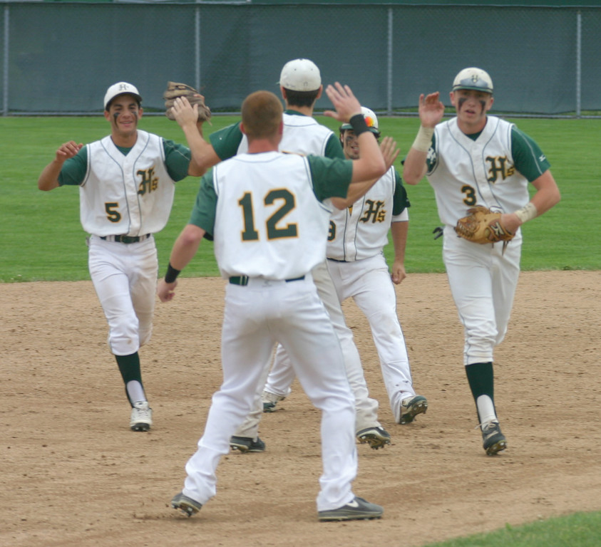 WELCOME BACK: Hendricken players celebrate after securing a berth in the Division I championship with a 5-2 victory over Johnston on Sunday. The Hawks rebounded from a loss on Saturday to win the series.