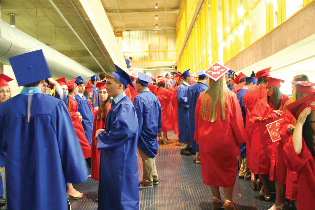 WAITING TO WALK: Toll Gate students line up for their graduation processional.