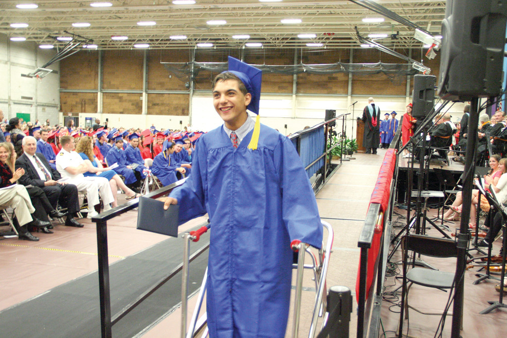 NOTHING BUT PRIDE: Domenic Paolella, a Toll Gate student with cerebral palsy, finishes his walk across the stage to get his diploma.