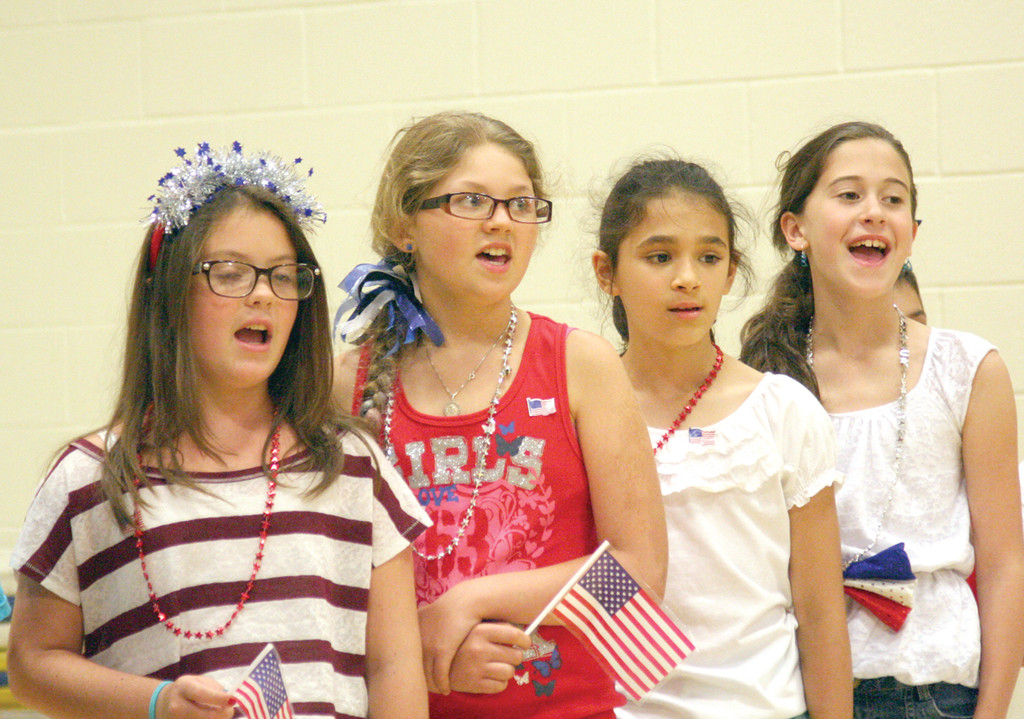 SINGING ALONG: Jenna Gustafson, Victoria Paglio, Jasmine Keegan and Elayna Commello sing with their classmates about the 50 states and their capitals to their parents and administrators.