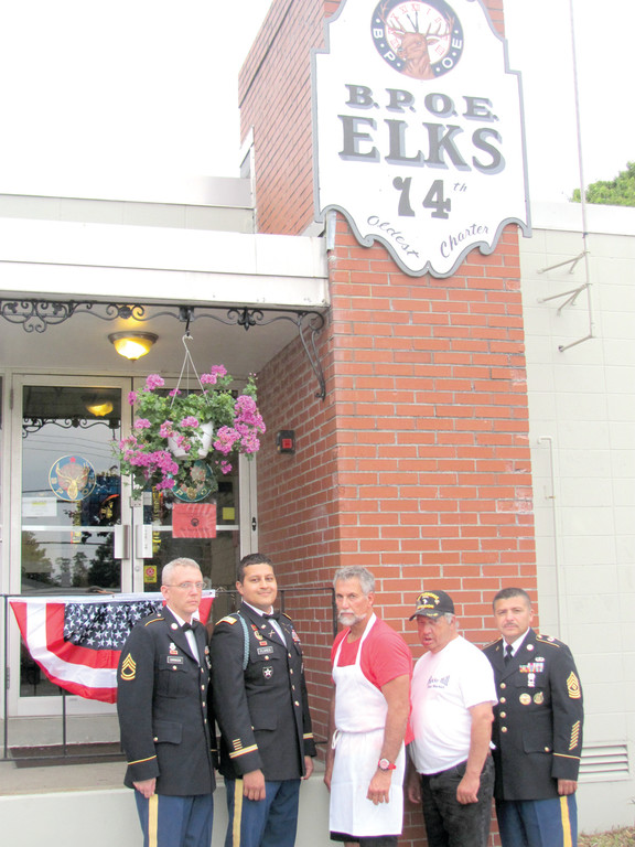 GRAND GUESTS: Exalted Ruler Mark Eaton (third left) is joined by U.S. Army Officers Captain David Flores, SFC Ronnie Simonsen, U.S. Army veteran Joseph Machado, who was awarded a Purple Heart, and S6 First Sergeant Martin Contreras at the start of the recent Veterans Appreciation Dinner at the Warwick-based Elks Lodge No. 14.
