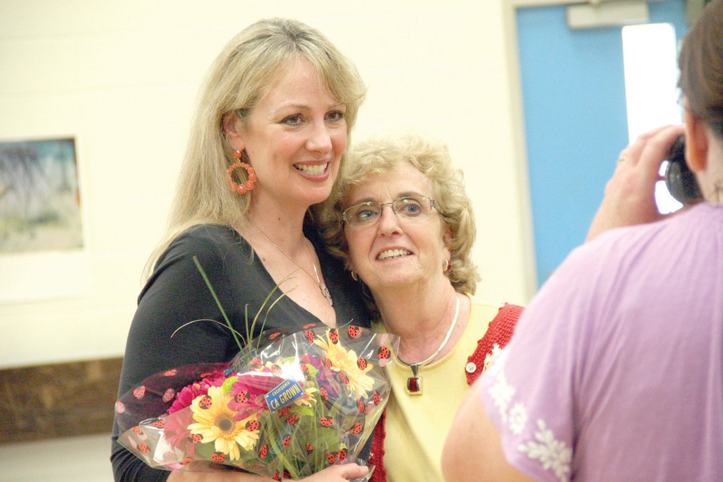 DEDICATION: Hoxsie art teacher Kim Markarian gives fifth grade teacher Kathy Curtis a hug following the show. Markarian dedicated the show to Curtis, who is retiring this year.