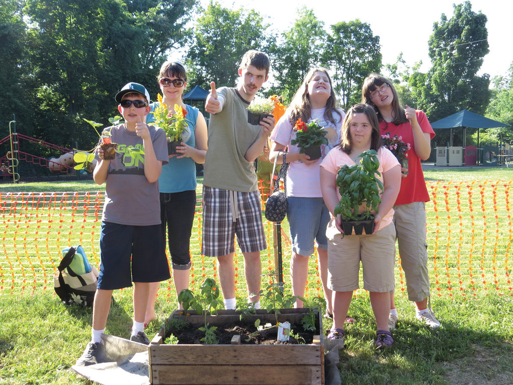 WATCH THEIR GARDEN GROW: Eric Carter, Michela Lombari, Michael Malouin, Cheryl Swiderski, Rachel Ghigliotii and Katie Blair were able to help with the inaugural planting at the Trudeau Center's new community garden.