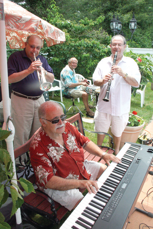 MUSIC MAKERS: Musicians have volunteered their talents to make for lively singing sessions, including the one Tuesday beside the Collinson pool. On piano is Tony Pisano. Others pictured are Stanley Freedman, cornet; Joe Holtzman, drummer; and Ira Rice, trumpet. Drummer Joe Vono, also a regular with the group, is not pictured.