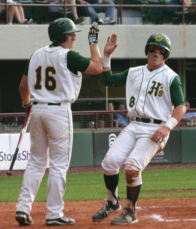 ON THE BOARD: John Toppa high fives Nick Boland after scoring a run in game one of the Division I championship series on Wednesday night at McCoy Stadium.