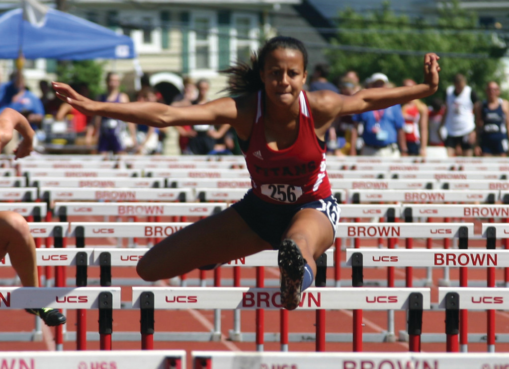 UP AND OVER: Erika Pena, pictured at outdoor states, won the Cox Sports Award for indoor track after medaling in two separate events at the state meet.