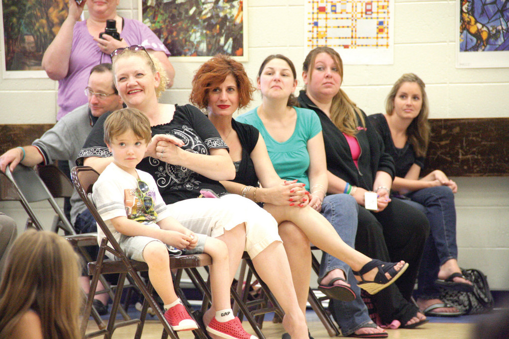 READY FOR A SHOW: Parents anticipate their children coming down the runway during the 4th annual Hoxsie Elementary School art and fashion show.