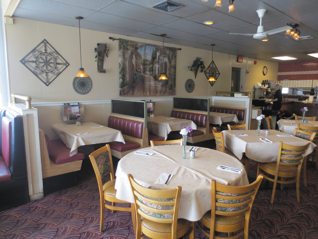 The dining room is set up and ready to serve a house of hungry diners at Rigatoni's on Warwick Avenue.