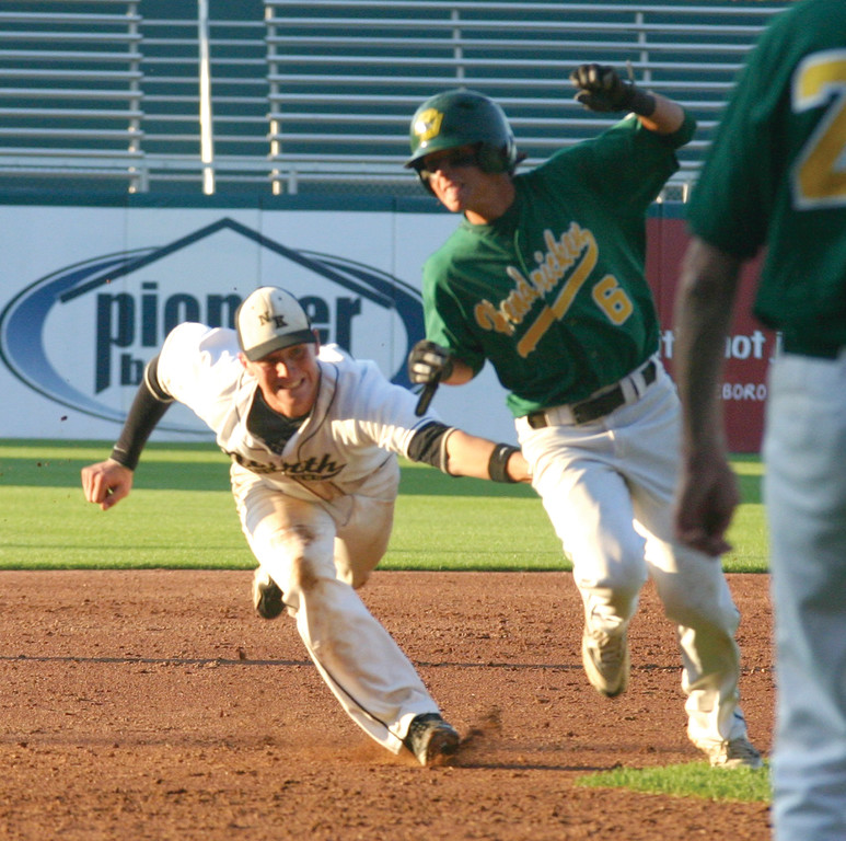 Matt Murphy avoids a tag on his way to third base.