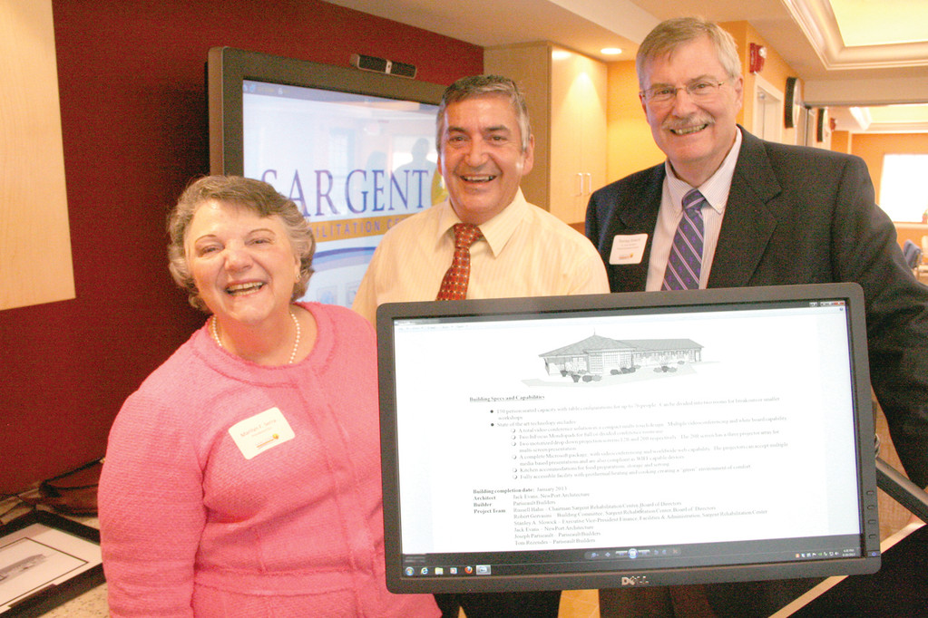 Pictured with Sargent President and CEO Marilyn Serra as they operate one of several computer-driven displays are Jack Evans of Newport Architecture LLC, who was the lead designer and project manager, and Stanley Slowick, senior vice president of finance and administration.