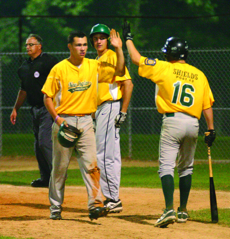 GREETINGS: Mike Mallozzi and Ryan Rotondo celebrate a ninth-inning run in Tuesday's victory over South Kingstown Post 39. NEFL won 5-2 to improve to 4-0 on the young season.