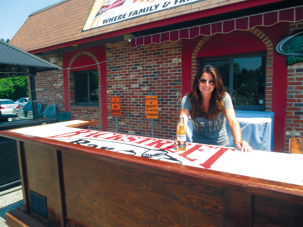 With the outside patio open, bartender Briana is getting ready to serve up some cool refreshment at this weekend's Steak Fry.