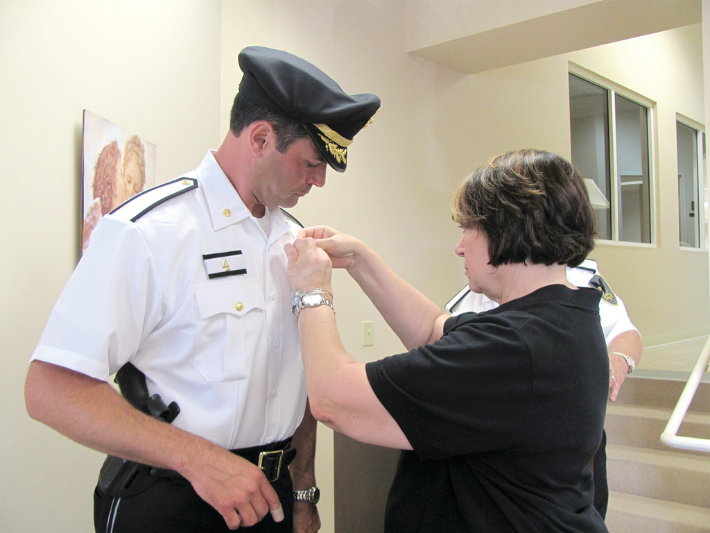 In  Johnston Police Department's tradition, Major Joseph Razza's mother Joan Razza had the privilege of pinning on her son'se new  badge.