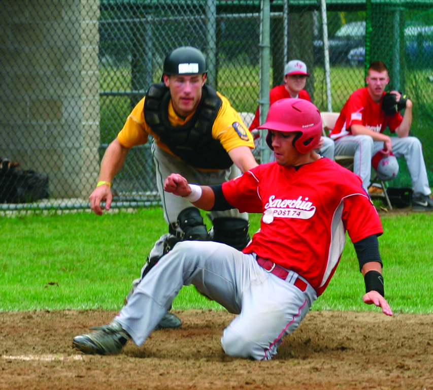 SLIDING IN: Senerchia's Gian Martellini hits home ahead of the tag from NEFL catcher Shawn Clayton.