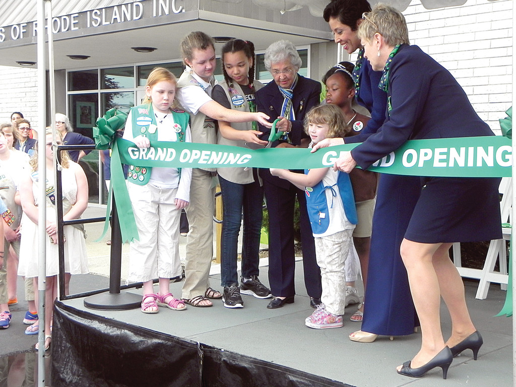 GRAND OPENING: Local Girl Scouts cut the grand opening ribbon to GSRI�s new center on Greenwich Avenue with the help of GSUSA CEO Anna Maria Chavez, GSRI CEO Jean Ann McGrane, and GSRI Honorary Board Member Betty Cugini.